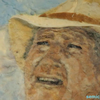 Слейтер Бэррон «Портрет актёра Джона Уэйна». Волокна тканей. Музей Рипли. Гранд-Прери, Техас, США