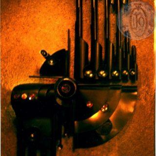 В.Д.Хахалкин. Панно «ФОТОН» (малое). 1986г. Бронза, тонированный алюминий, медь, цветное стекло